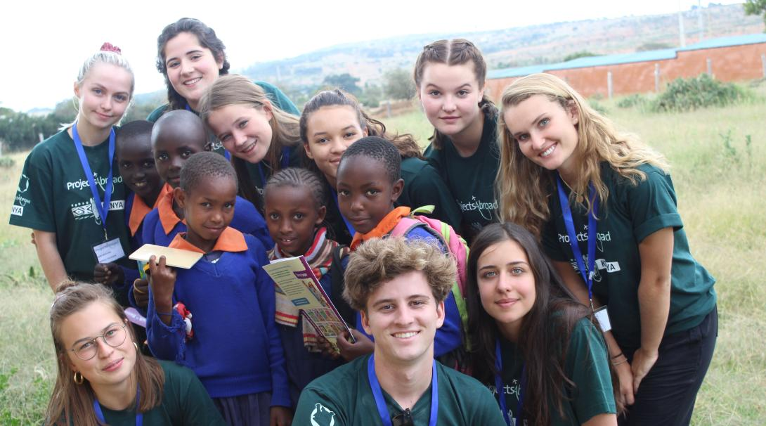 High School volunteer take a picture with the beneficiaries of their Childcare Project in Kenya.